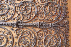 Wrought iron on wood. Element of the etrance door of the Notre-Dame Cathedral in Paris - wrought iron on wood Royalty Free Stock Images