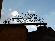 Wrought Iron Work Against A Cloudy Sky Stock Photography