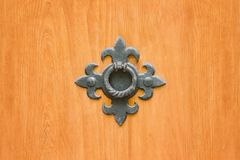Wrought metal ring on a wooden door. Close up.  stock photo