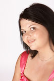 Wry smile. Slightly overweight female model with shy smile stock photos