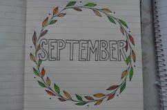 Wrzesień pisać na stronie notatnik zdjęcie stock