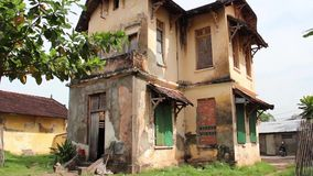 WS (#3) low angle tilt down old French Colonial prison building in Asia stock video