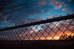 Wschód słońca i ogrodzenie fotografia royalty free