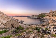 Wschód słońca i prom przy Ile Rozbudzamy w Corsica Fotografia Stock