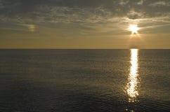 Wschód słońca i sundog przy końcówką jezioro Obrazy Royalty Free