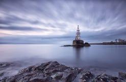Wschód słońca latarnia morska w Ahtopol, Bułgaria Błękitny godziny seascape długo ekspozycji Obraz Royalty Free