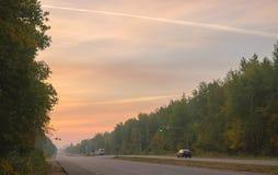 Wschód słońca na drodze Zdjęcie Royalty Free