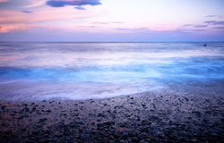 Wschód słońca na wodzie Obraz Royalty Free