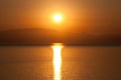 Wschód słońca na wodzie Grecja Zdjęcia Stock