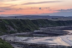 Wschód słońca nad Scarborough falezami północ, fotografia royalty free