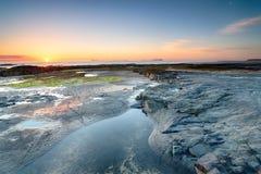 Wschód słońca przy Banburgh plażą zdjęcie royalty free