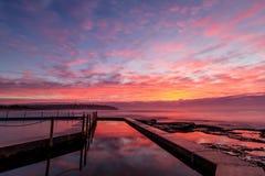 Wschód słońca przy południe kędzioru kędzioru rockpool Fotografia Royalty Free