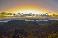 Wschód słońca wśród chmur Obrazy Royalty Free
