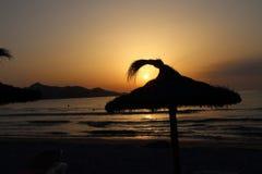 Wschód słońca w parasolu Zdjęcie Stock