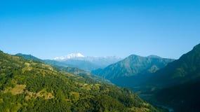 Wschodu słońca above szczyt w himalaje pasmie, Nepal Zdjęcia Stock