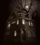 wschodzi księżyc w domu Fotografia Stock