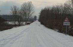 Wsi droga zakrywająca z mnóstwo śniegiem podczas zimy Obraz Royalty Free