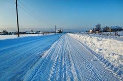 wsi drogowa Russia zima Obrazy Royalty Free