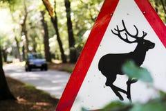 wsi jeleni drogowego znaka ostrzeżenie zdjęcie stock