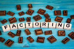 Wskazujący czynniki słowo pisać na drewnianym bloku Drewniany abecadło na błękitnym tle Obrazy Royalty Free
