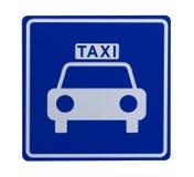 wskazujący drogowego znaka stojaka taxicab Obrazy Stock