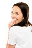 Wspaniała młoda dziewczyna uśmiecha się flirtować odizolowywam na białym backgroun Zdjęcia Stock
