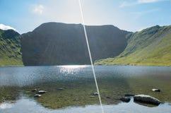Wspina się Helvellyn, 950 metres wysokiego above Jeziornego Ullswater Obrazy Stock