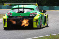 WSR Budapest, Hungary - JULY 3:. Renault Megane race car blowing fire on the Hungaroring race track at World Series by Renault,on July 3, 2011 in Budapest stock image