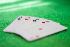 Wszystkie as na zielonym stole obraz royalty free