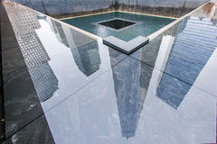 1 WTC reflected on a 911 Memorial Pool. Reflection of One World Trade Center (aka, 1 World Trade Center, One WTC, 1 WTC, Freedom Tower) on the North Pool of the Royalty Free Stock Photography