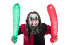 Wütendes und gruseliges Clownkostüm mit den Ballonen, lokalisiert auf Weiß Stockfotos