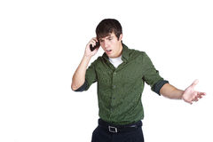 WTF!?! Angry young man on cell phone. A happy young man talks on his cell phone stock photography
