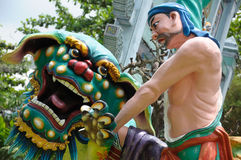 Wu Song slaying a tiger. A photo taken on the warrior Wu Song slaying a tiger statue tableaux at Haw Par Villa in Singapore Royalty Free Stock Photo