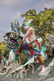Wu Song Slaying Tiger Statue at Haw Par Villa. SINGAPORE - FEBRUARY 1, 2014: Ancient Chinese Warrior Wu Song Slaying Tiger Statue Diorama at Haw Par Villa Theme Royalty Free Stock Image