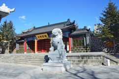 Wudalianchi, China. Sculpture of the mythological lion in front of the entrance to the temple  Zhongling  on the top of extinct Ya Royalty Free Stock Photos