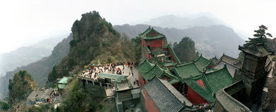 Wudang Mountains, Wudangshan. Top view overlooking Wudangshan or Wudang mountains, also known as Taoist sacred mountains. Ancient Building Complex sits on Wudang Royalty Free Stock Images