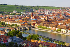 Wuerzburg. At a late sunny afternoon with view towards the Alte Mainbruecke and vineyards in the background Stock Photo