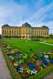 Wuerzburg residence in spring. Wuerzburg residence of Franconia, Bavaria, Germany, spring with garden with colorful flowers and clear sky. green grass big stock photo