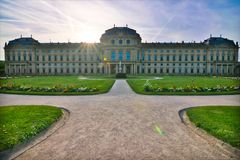 Wuerzburg residence in spring summer. Wuerzburg residence of Franconia, Bavaria, Germany, spring with garden with colorful flowers and clear sky. green grass big stock photography