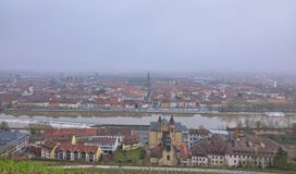 Wuerzburg city view from top. Wuerzburg is a small nice city in Bavaria, Germany.  The photo is taken on a foggy day in January Royalty Free Stock Photo