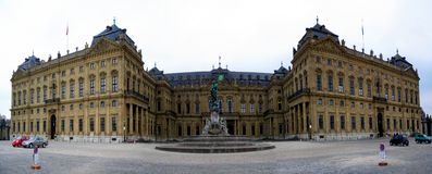 Wuerzburger Residenz. Panoramic capture of the Wuerzburger Residenz with fountain in foreground Royalty Free Stock Photography