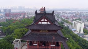 WUHAN, CHINA - MAY 2, 2017: red gate bell temple park day yellow crane aerial drone view panorama