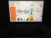 Taobao website homepage on laptop screen stock image