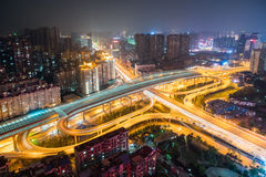 Wuhan overpass at night. Wuhan city interchange at night, cityscape with traffic infrastructure background, China Stock Photo