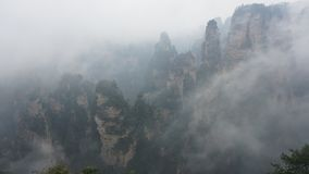 Zhangjiajie, Wulingyuan Scenic and Historic Interest Area. Wulingyuan Scenic and Historic Interest Area is located in Hunan of China. Foggy weather made those royalty free stock image