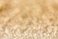 Wunderbarer romantischer weicher Gold-bokeh Hintergrund Stockfoto