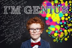 Wunderkind child boy on chalkboard background with science formula and art pattern.  stock photo