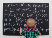 Wunderkind little boy on math Royalty Free Stock Images