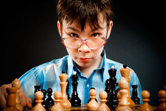 Wunderkind  play chess Stock Photos