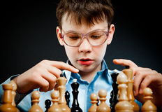 Wunderkind play chess Royalty Free Stock Image